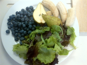 Smoothie ingredients - frozen banana, mixed leaves, blue berries, pear
